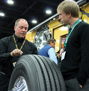 continental truck tire product manager johnny cape explains fuel-efficient tire construction to a show attendee at the 2013 mid-america trucking show.